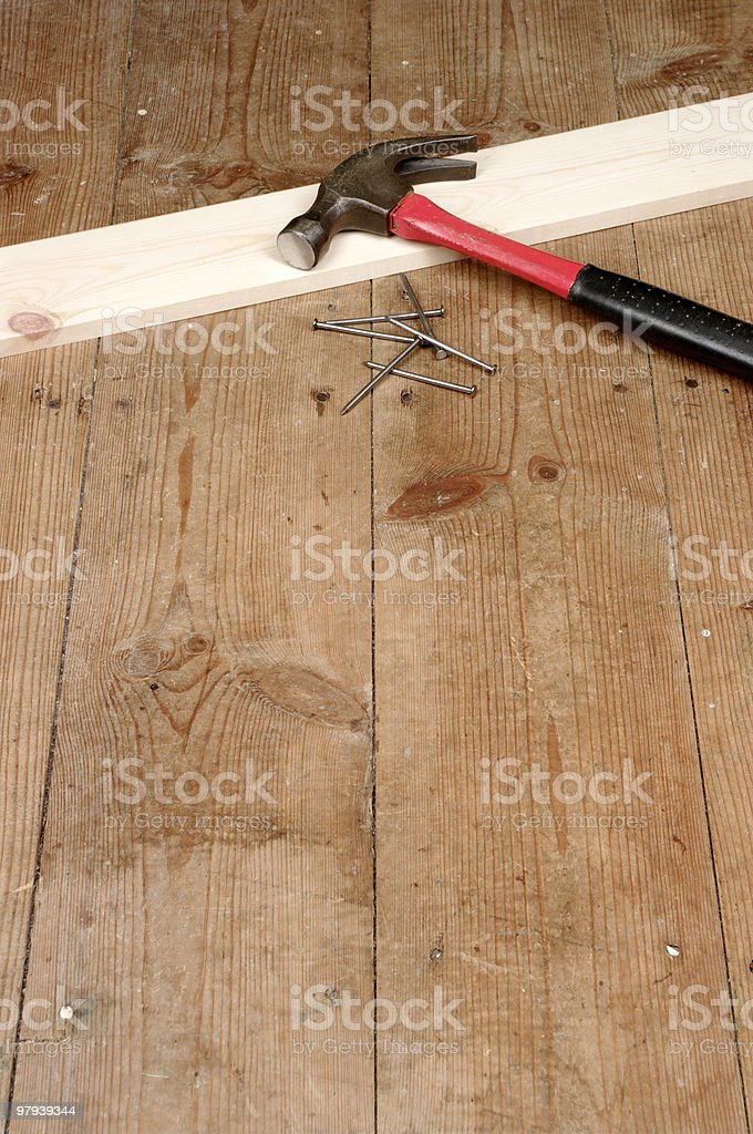 Claw Hammer And Nails On Wooden FLoor royalty-free stock photo