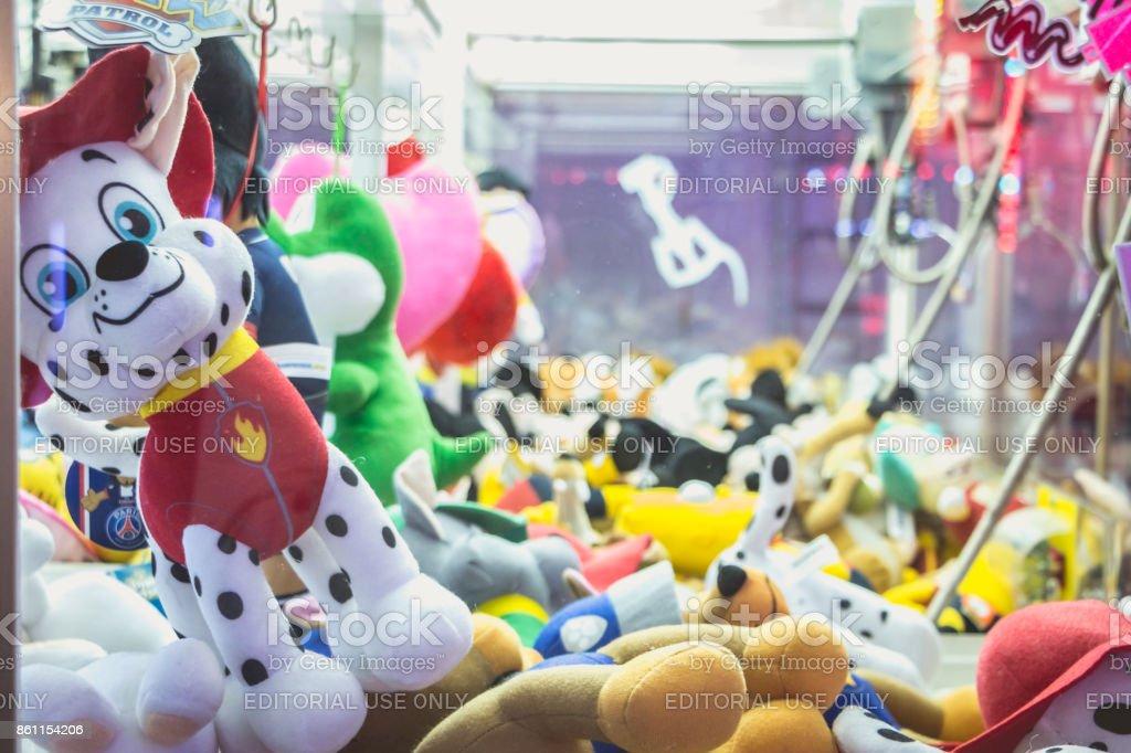 claw machine allows to win stuffed animals stock photo