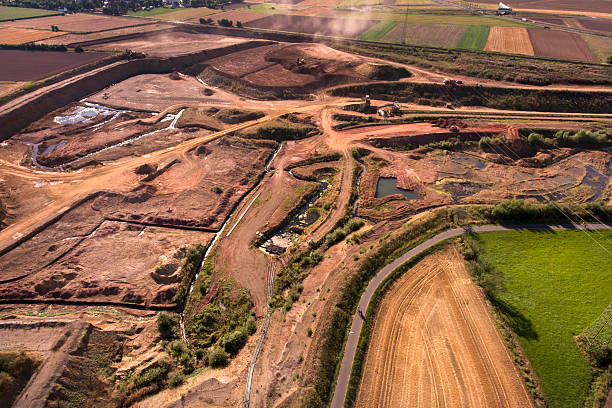 clay and gravel pit - aerial view - aerial view soil germany stock-fotos und bilder