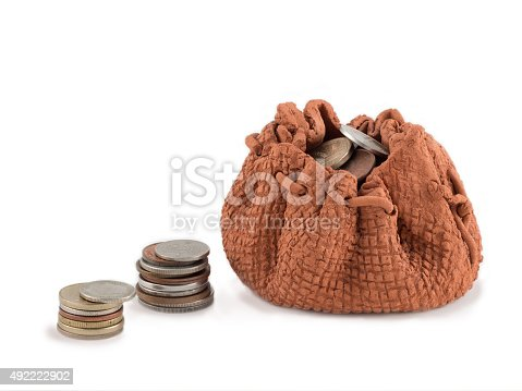 482747823istockphoto Clay bag with money and column of coins isolated 492222902