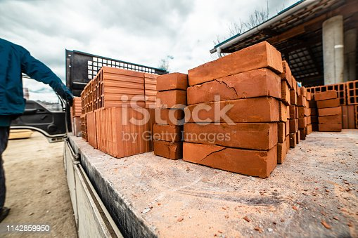 Clay bricks construction material loaded in the back of the delivery truck
