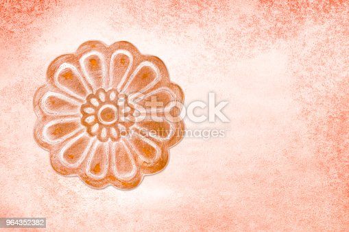 Clay decorative element on textured wall. Space for text, clipping path included.