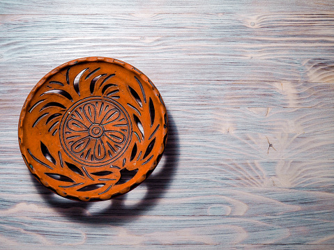 clay dish on a wooden background