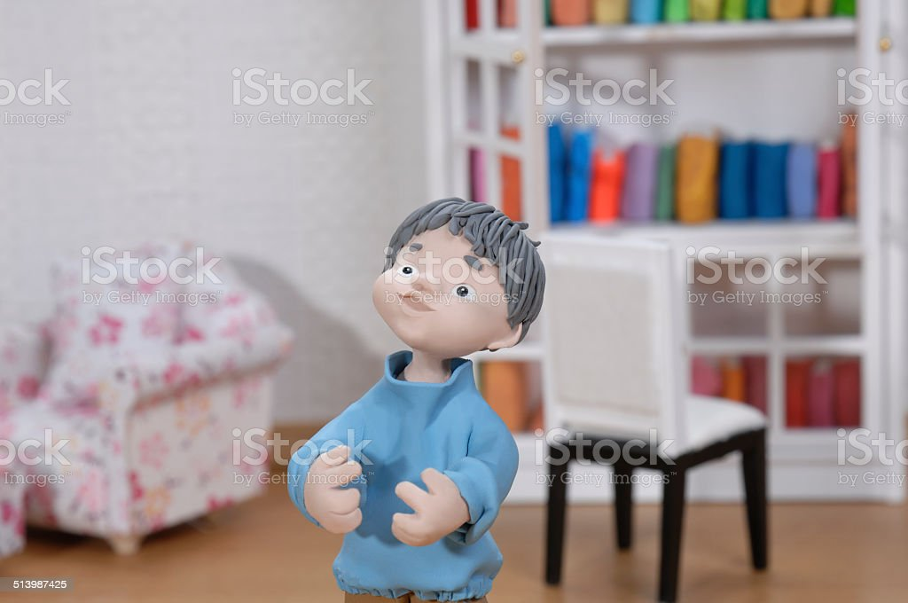 clay doll boy  in his miniature room. stock photo