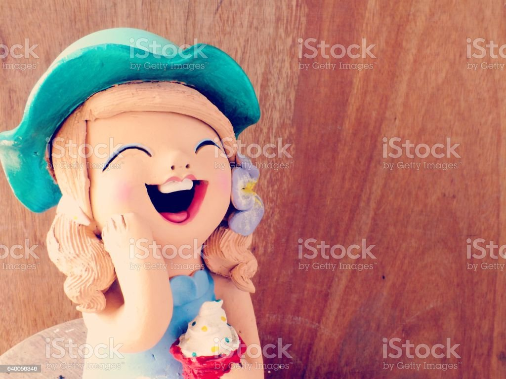 clay dolls children girl smiling and laughing on wooden background stock photo