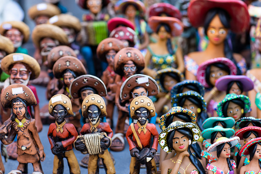 Clay dolls. Clay dolls from Brazil. Concept of musicians and women.