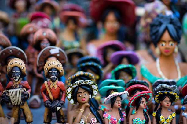 Clay dolls. Clay dolls from Brazil. Concept of musicians and women. stock photo