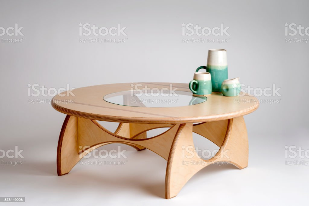 Clay Drinking Set on Designer Bare Wood Round Table stock photo