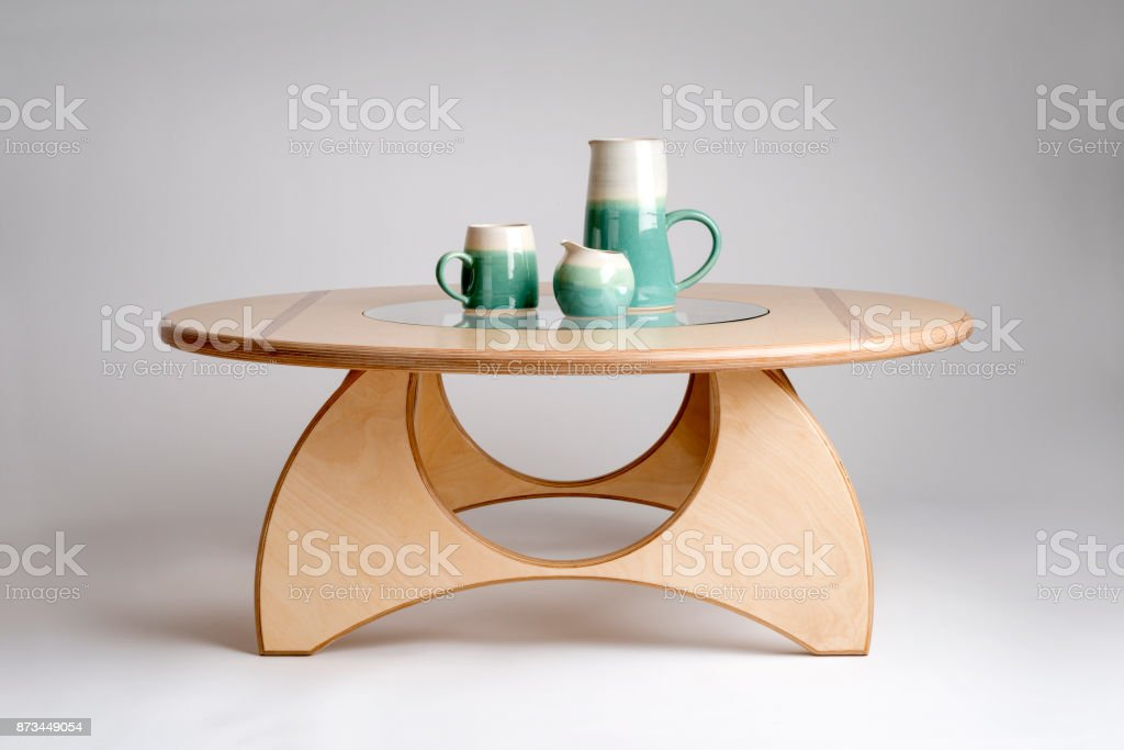 Clay Drinking Set on Modern Natural Wood Round Table Top stock photo