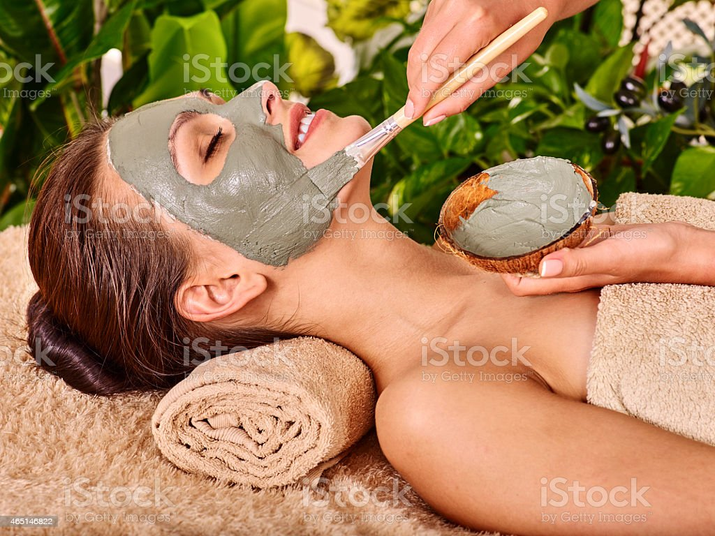 Clay facial mask in beauty spa stock photo