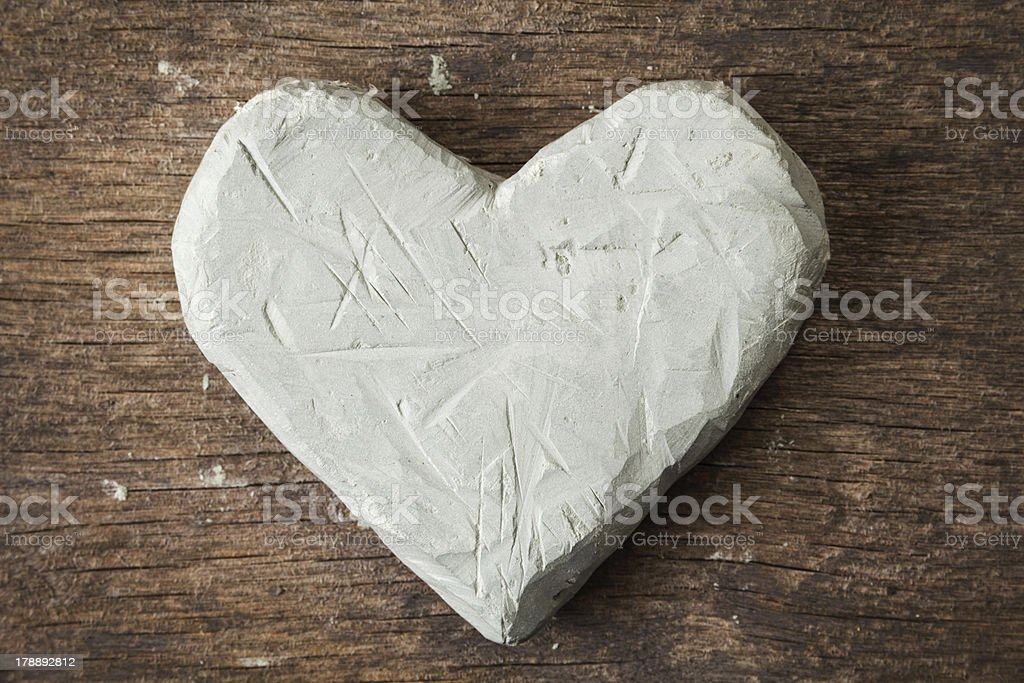 clay heart on wooden surface royalty-free stock photo