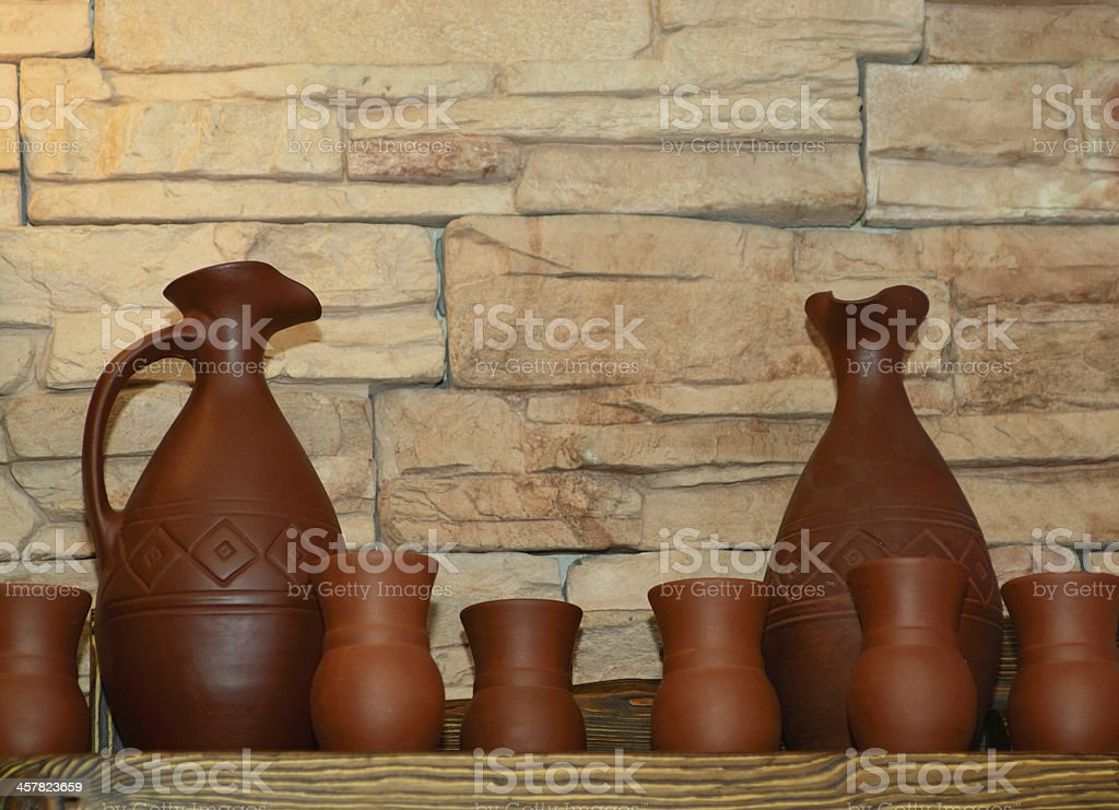 Clay jugs and cups on a shelf royalty-free stock photo