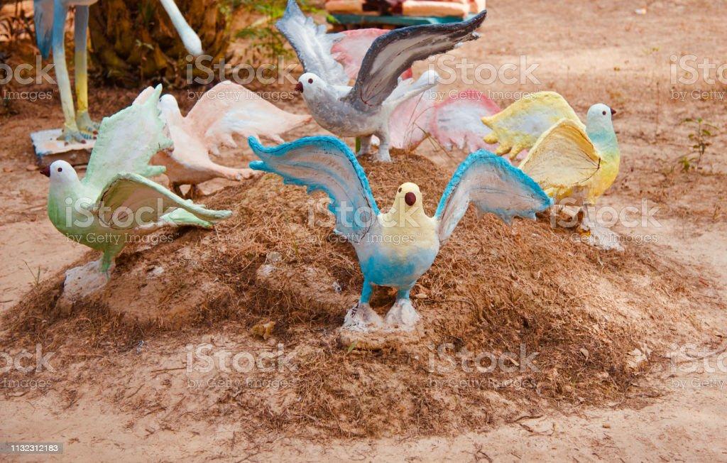 Clay made artificial birds around a park stock photo