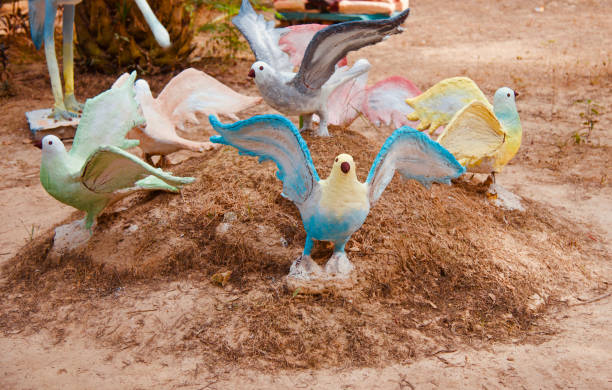 Clay made artificial birds around a park stock photo