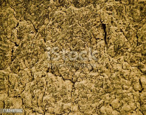 istock Clay made brown surface isolated background photo 1182497000