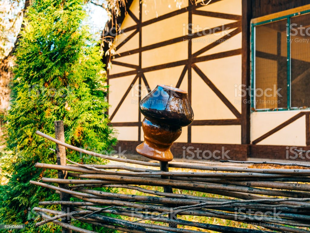 Clay pot on the fence royalty-free stock photo