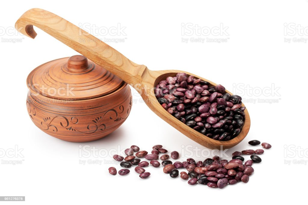 clay pot, wooden spoon, beans stock photo