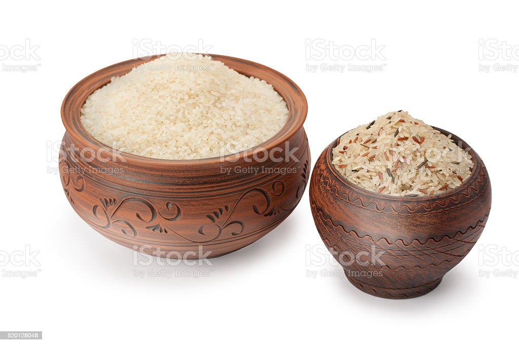 clay pots with rice isolated on white background stock photo