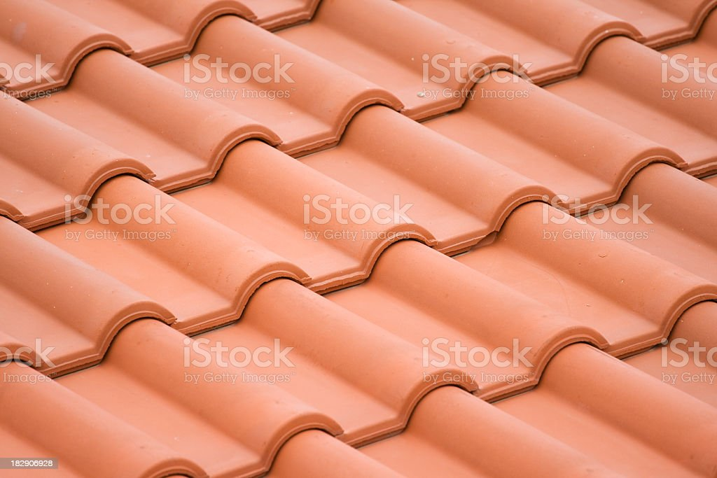 Clay roof tiles pattern on slight incline stock photo