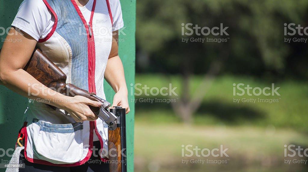 clay shooter reloading shotgun stock photo