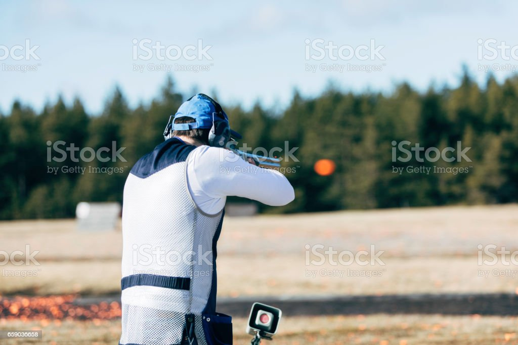 Professional trap shooter shooting clay targets.
