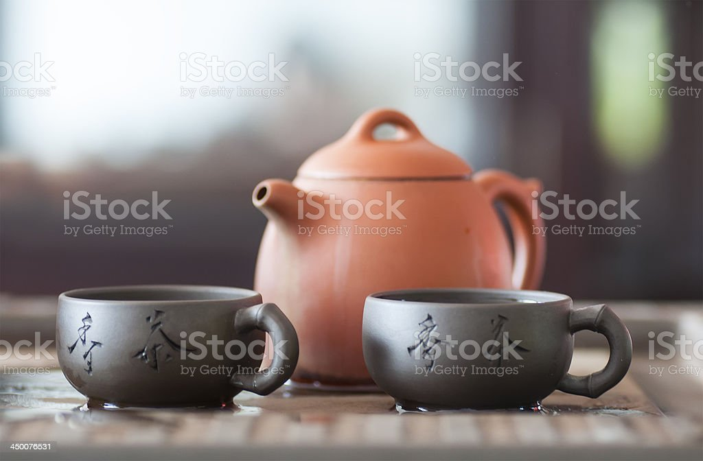Clay teapot and two cup of green tea stock photo