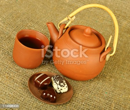 istock Clay teapot with sweets 114398333