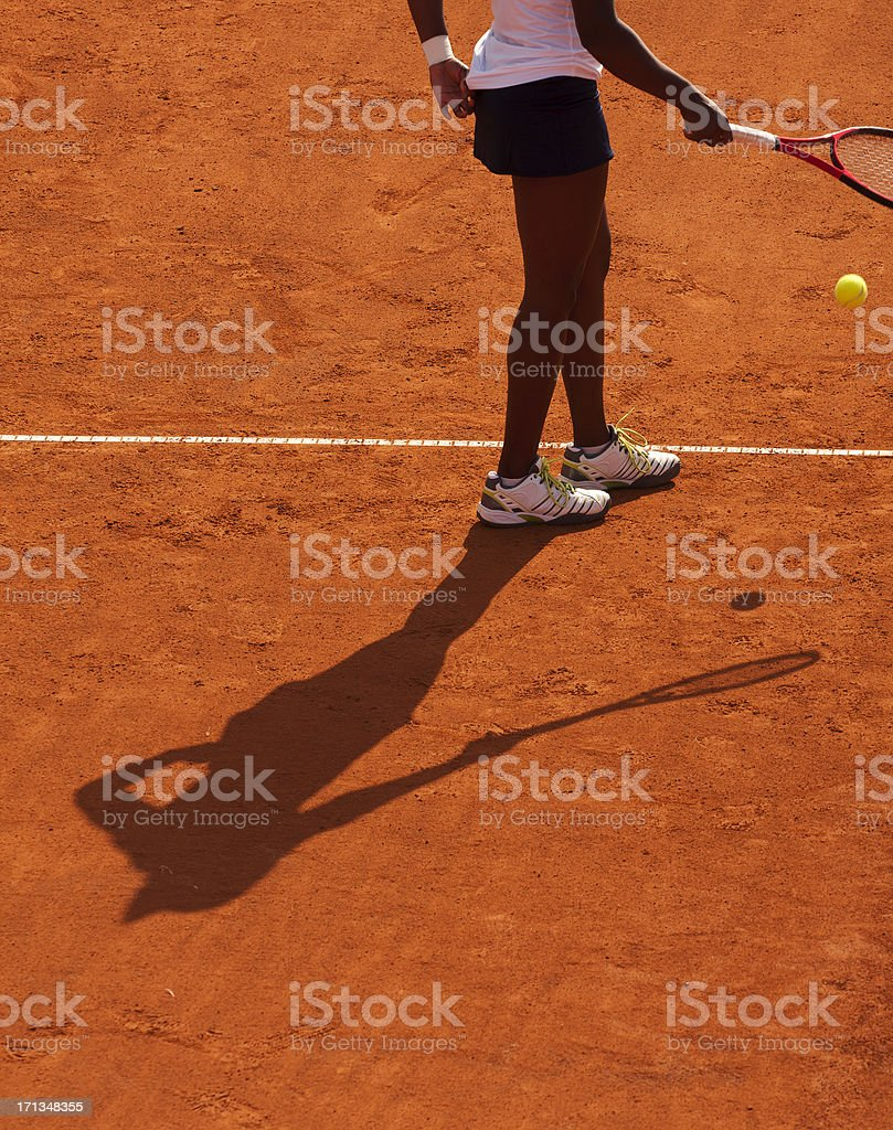 Clay tennis court and player concept stock photo