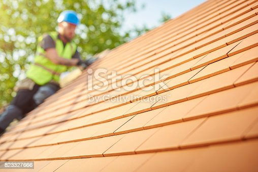 istock clay tiled roof installation 823327666