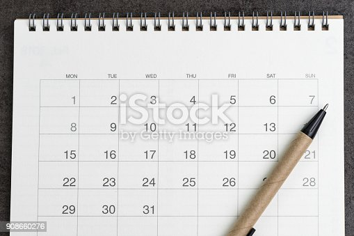 istock Clean and clear calendar with pen on black  background using as year planning or holiday vacation plan 908660276