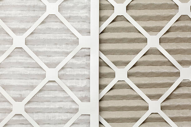 Clean and dirty air filters, side-by-side stock photo
