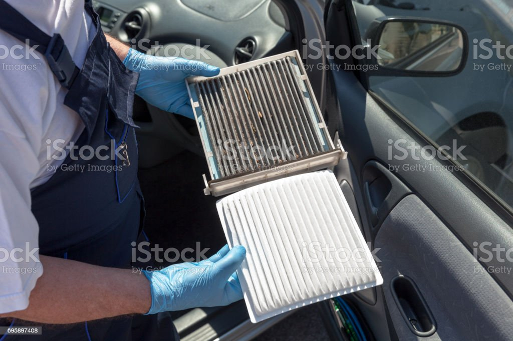 Clean and dirty cabin air filter for the car stock photo