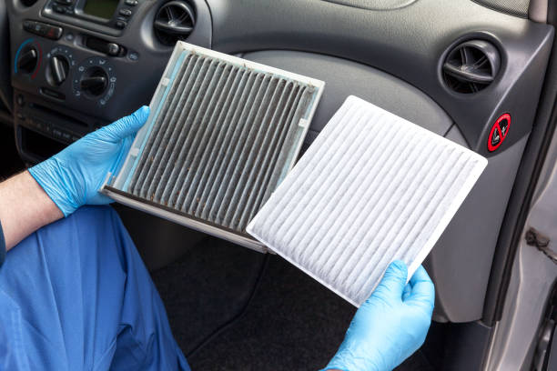 Clean and dirty cabin pollen air filter for a car Replacing an old car cabin air filter passenger cabin stock pictures, royalty-free photos & images