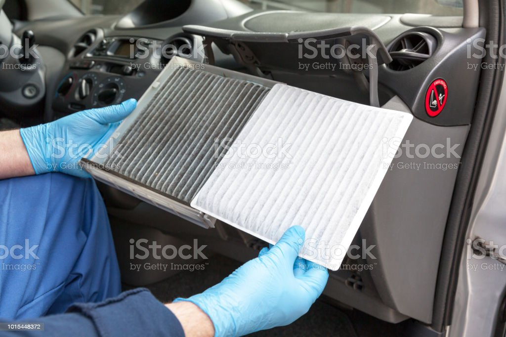 Clean and dirty cabin pollen air filter for a car stock photo