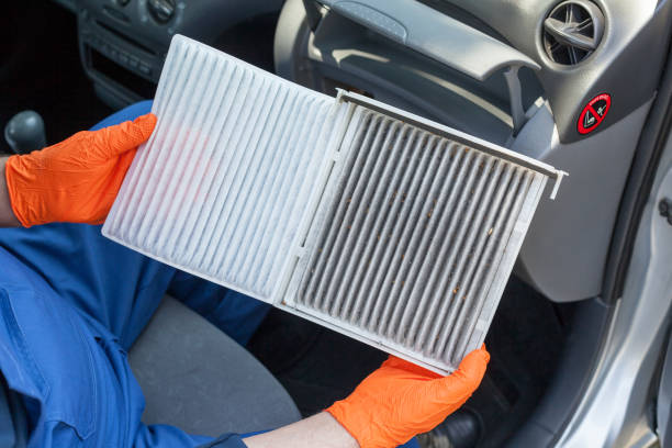 Clean and dirty cabin pollen air filter for a car Replacing an old car cabin air filter flower part stock pictures, royalty-free photos & images