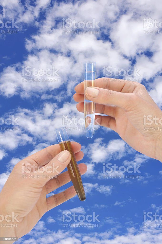 Clean and dirty water samples in hands royalty-free stock photo