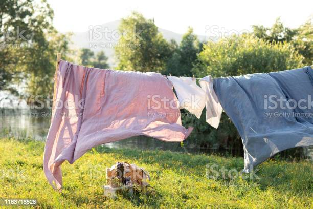 Clean bed sheet hanging on clothesline picture id1163718826?b=1&k=6&m=1163718826&s=612x612&h=96ju1nv1usyxj1 excpsijdxyhij1rmgntvz0 go im=