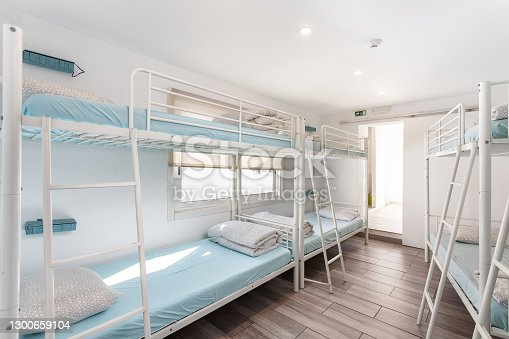 Clean bedroom with bunk beds in a hotel, a hostel for tourists