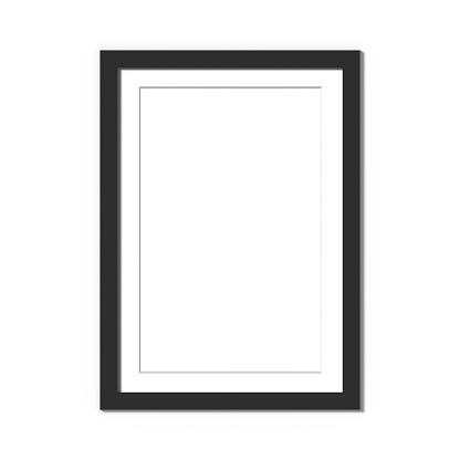 Black picture frame isolated on white with thin white mat