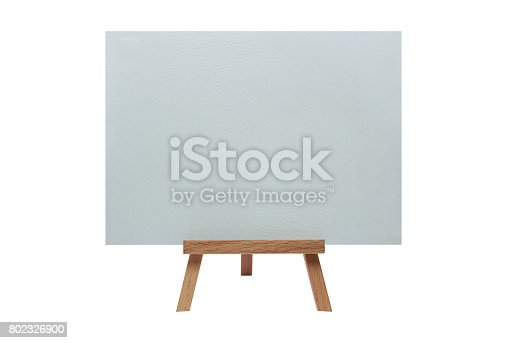 istock Clean canvas on an easel on an isolated background 802326900