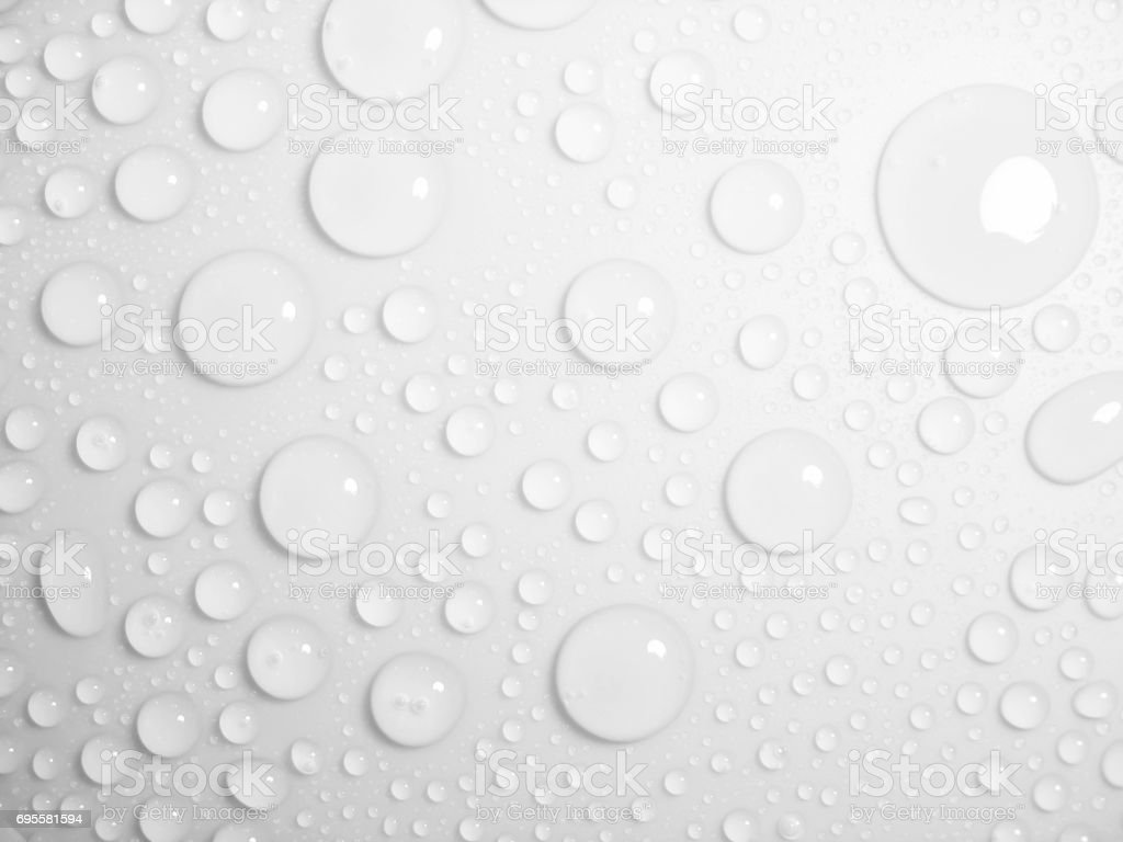 Clean clear water drop background on a bright white surface stock photo