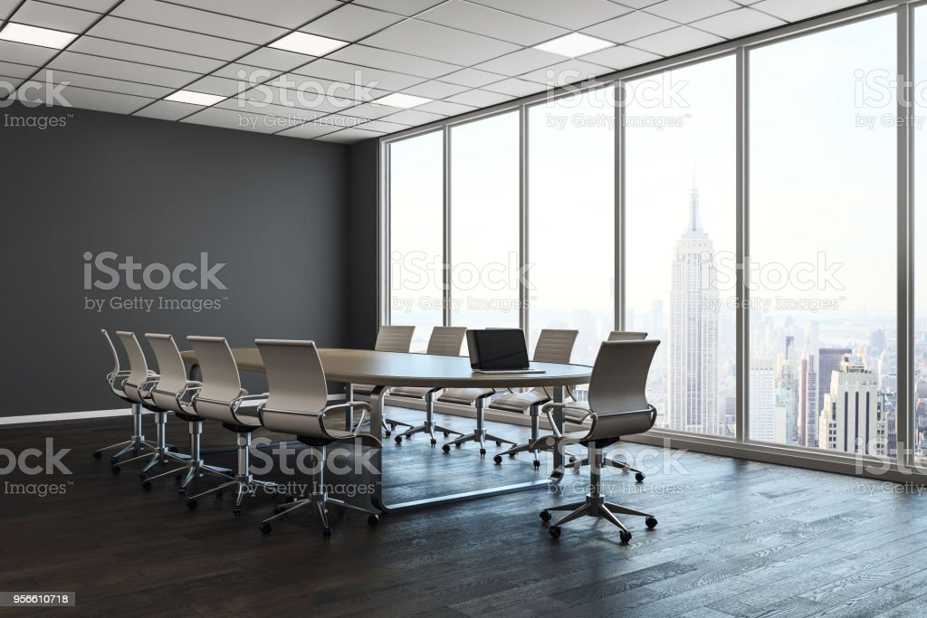 Clean conference room interior with copy space on wall and city view...