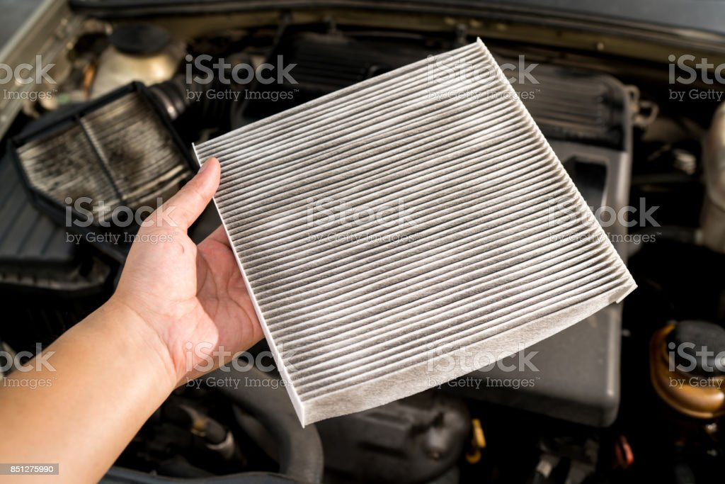 Clean console modern car, air filter, dirty. stock photo