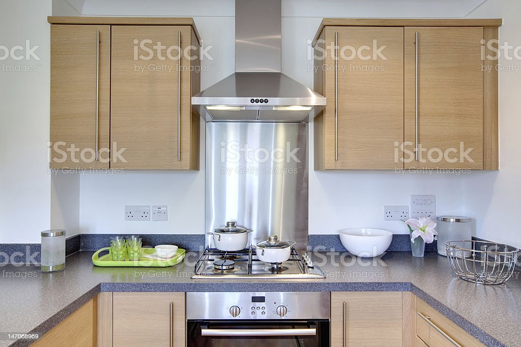 A clean contemporary kitchen with steel oven and stove stock photo
