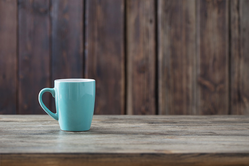 clean cup on old wooden background