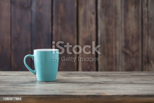 clean empty cup on old wooden background