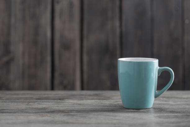 clean cup on old wooden background stock photo