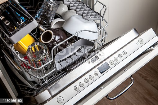 Clean dishes in dishwasher machine after washing cycle