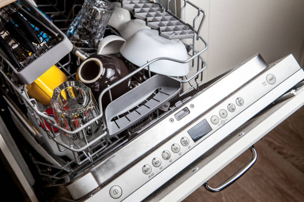 Clean dishes in dishwasher machine after washing cycle Clean dishes in dishwasher machine after washing cycle dishwasher stock pictures, royalty-free photos & images