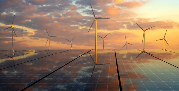 clean energy concept, photovoltaic panels and wind turbines in the light of the rising sun clean energy concept, photovoltaic panels and wind turbines in the light of the rising sun wind power stock pictures, royalty-free photos & images